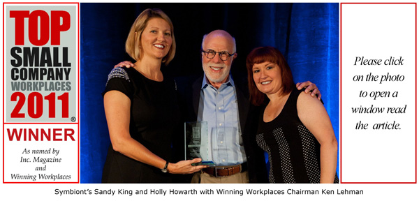 Symbiont's Sandy King and Holly Howarth with Winning Workplaces Chairman Ken Lehman in 2011