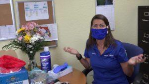 Sandy King wearing mask